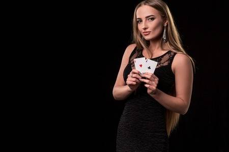 93788489-young-beautiful-woman-playing-in-casino-girl-holding-the-winning-combination-of-poker-cards-two-aces